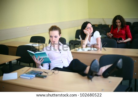 relax in the classroom, but not all students - stock photo