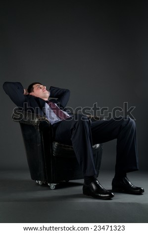 relax of the businessman on dark background