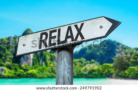 Relax sign with a beach on background - stock photo