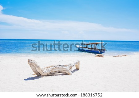 Relax White Sand Beach, Blue Sea and Boat under Sky - stock photo