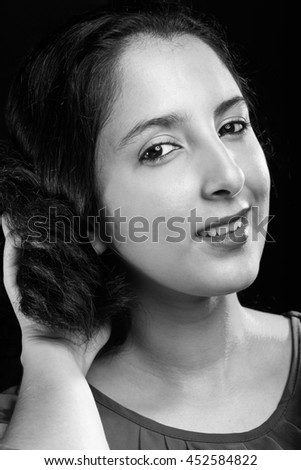 relax young latina woman portrait in black and white