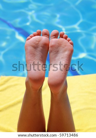 Relaxation at swimming pool - stock photo