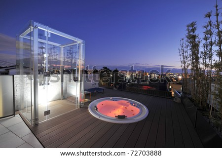 Relaxation in luxury bubble bath at night on red - stock photo