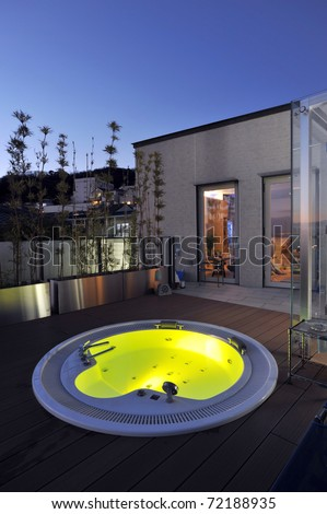 relaxation in luxury bubble bath at night on yellow-2 - stock photo