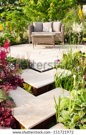 Relaxation place in a garden - stock photo