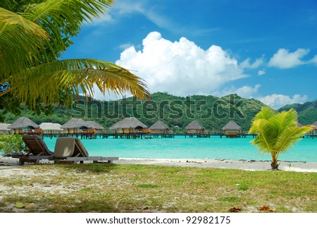 Relaxation with the beach , the palms and the lagoon in a luxury resort , Bora Bora , French Polynesia, South Pacific ocean