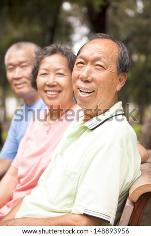 relaxed asian seniors in the park - stock photo