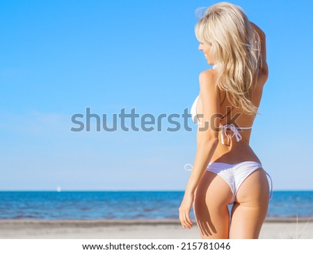 Relaxed beautiful woman enjoying a day on the beach - stock photo