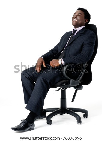 relaxed black businessman sitting in office chair isolated on white - stock photo