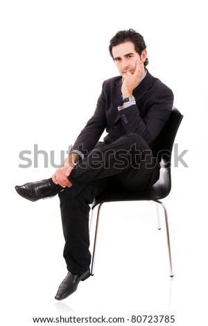 Relaxed business man sits on office chair over white background
