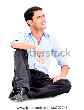 Relaxed business man sitting on the floor and smiling - isolated over white - stock photo