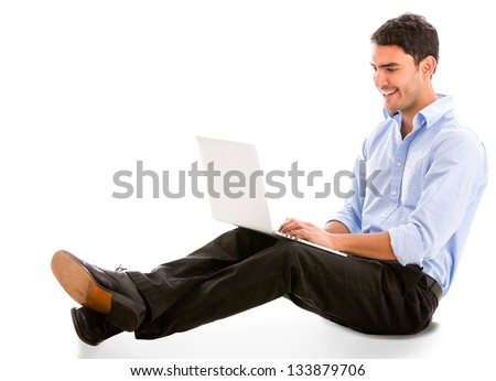 Relaxed business man working on a laptop - isolated over white - stock photo