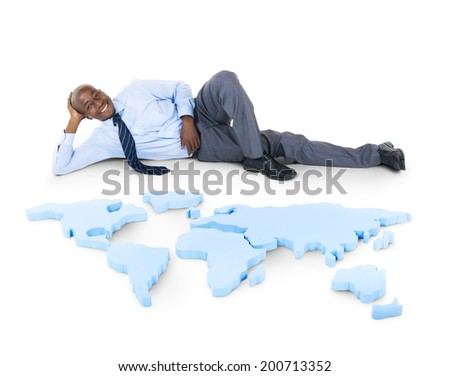 Relaxed Businessman on the Earth - stock photo