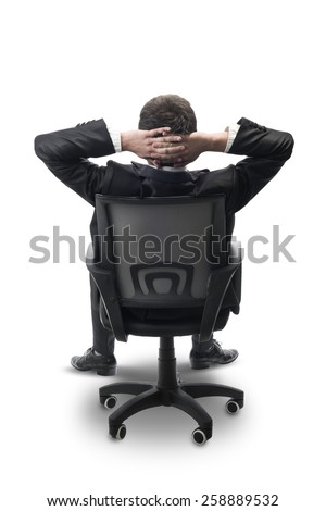 relaxed businessman sitting in office,isolated on white with clipping path