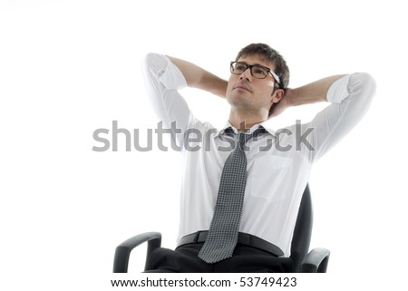 Relaxed businessman with hands behind his head - stock photo
