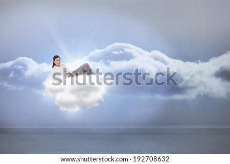Relaxed businesswoman lying against clouds in a room