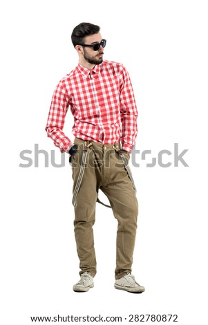 Relaxed casual hipster with hands in pocket looking away. Full body length portrait isolated over white background.  - stock photo