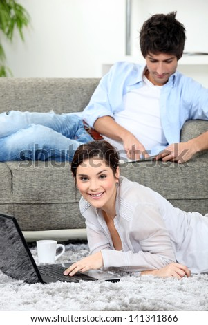 Relaxed couple at home - stock photo