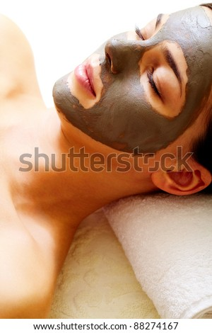 Relaxed girl having pore cleaning procedure in parlor - stock photo