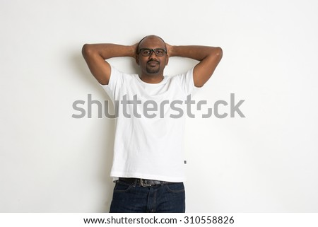 Relaxed looking casual indian male - stock photo