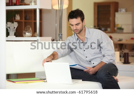Relaxed man in front of a laptop computer