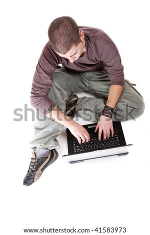 relaxed man with laptop computer over white - stock photo