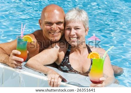 relaxed mature couple enjoying summer holidays - stock photo