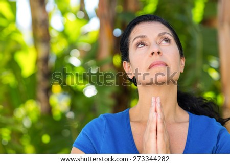 Relaxed woman doing yoga on a sunny day - stock photo