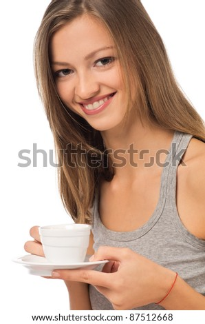 Relaxed woman drinking a coffee sitting on her bed at home - stock photo