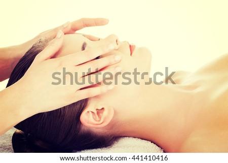 Relaxed woman enjoy receiving face massage - stock photo