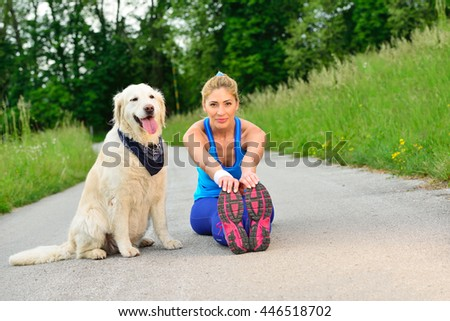 Relaxed woman enjoying relax and tranquility outdoor. Female on weekend leisure with dog. Young happy girl with her pet after running. - stock photo