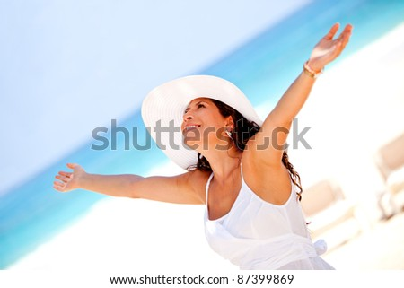 Relaxed woman in a peaceful beach enjoying her holidays - stock photo