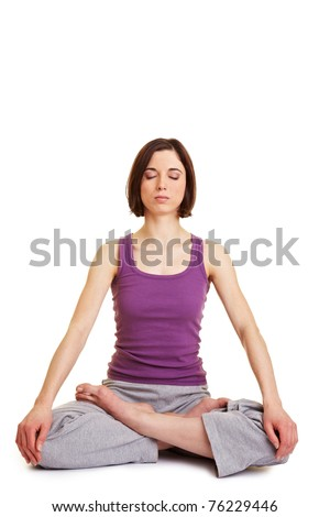 Relaxed woman in tailor seat doing yoga and meditation - stock photo
