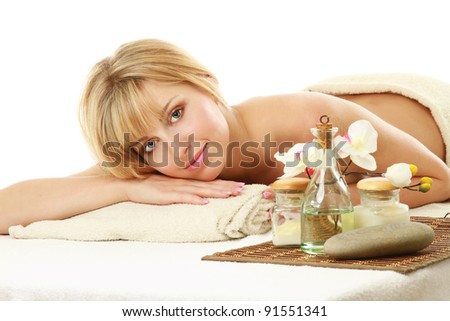 Relaxed young blonde at spa salon, isolated on white background - stock photo