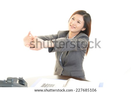 Relaxed young business woman. - stock photo