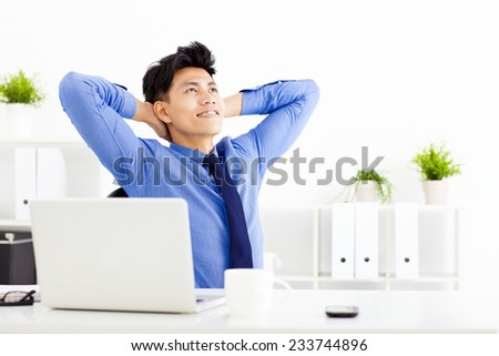 relaxed Young businessman working in the  office - stock photo