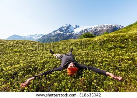 Relaxing backpacker  in mountains. - stock photo
