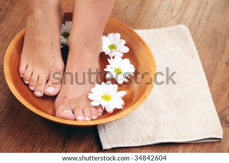 relaxing bath for feet - beauty treatment - stock photo