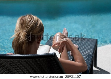 Relaxing by the pool - stock photo