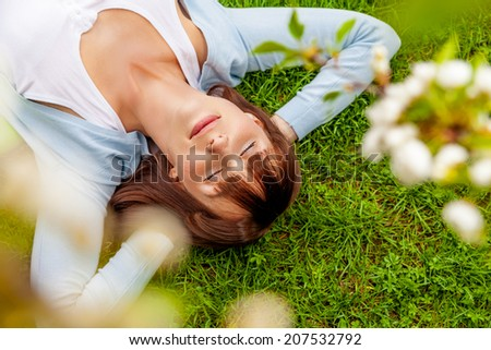 relaxing dreaming carefree female on the ground - stock photo