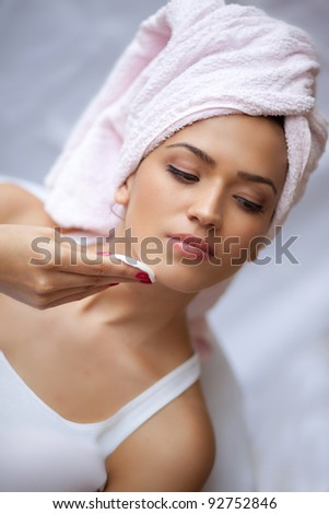 Relaxing during a facial steam treatment at a beauty spa. - stock photo