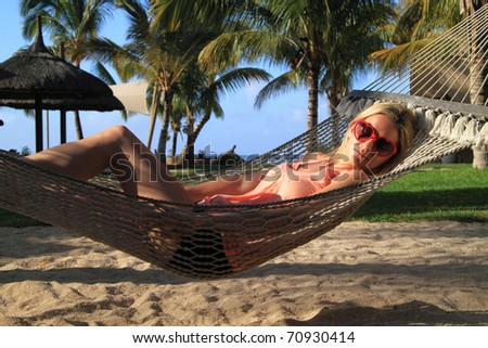 Relaxing in a hammock in paradise - stock photo