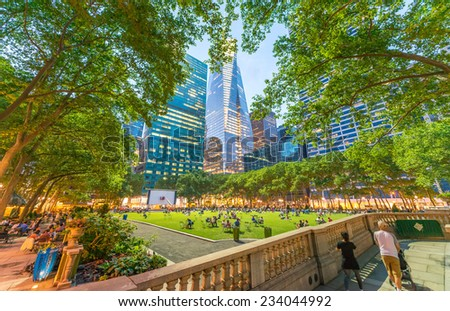 Relaxing in Bryant park after dusk. Manhattan, New York City. - stock photo