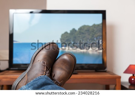 Relaxing in front of tv - stock photo