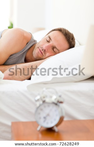 Relaxing man sleeping in his bed - stock photo