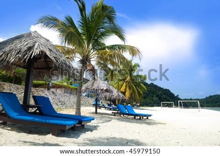 Relaxing on beach. Deck chairs on Teluk Chempedak, Malaysia. - stock photo