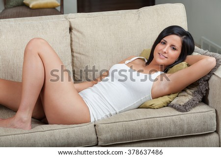 Relaxing on sofa - stock photo