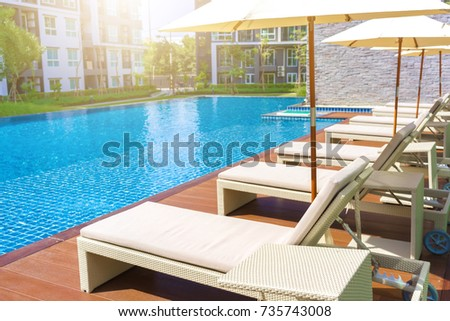 Relaxing Pool Bed Beside Swimming Pool Stock Photo (Royalty Free) 735743008    Shutterstock