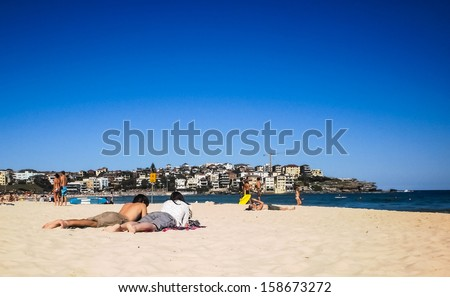 Relaxing time at Bondi beach,Sydney in the sunny day. - stock photo
