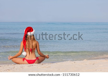 relaxing woman at beach christmas vacation - stock photo